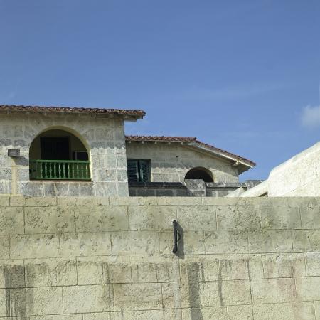 Old tropical villa made of stone blocks Stock Photo