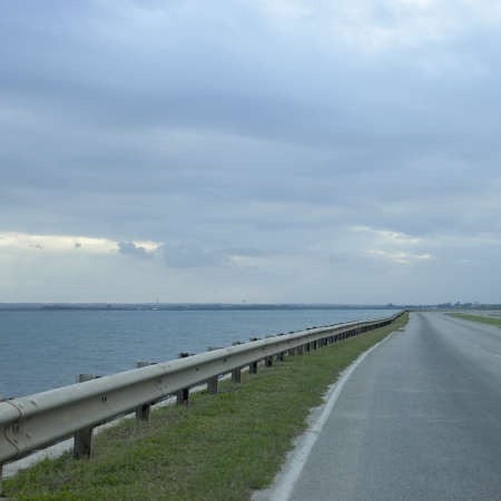 guard rail: side of highway and blue ocean Stock Photo