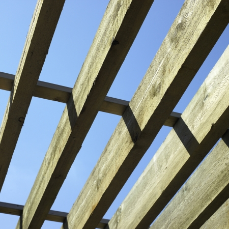 perpendicular: large wooden beams and blue sky