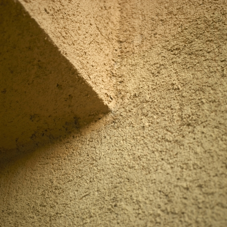 orange stucco wall close up photo