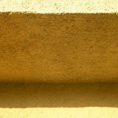 orange stucco wall close up Stock Photo