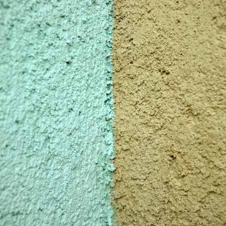 stucco: turquoise and orange stucco wall close up