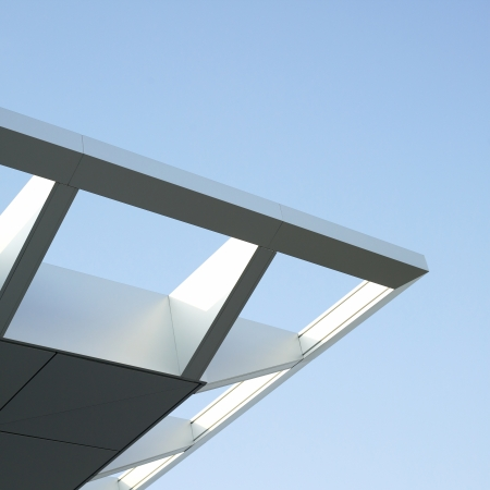 minimal: Modern architectural building awning against blue sky Stock Photo