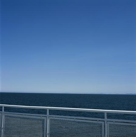 White metal railing against the blue ocean Reklamní fotografie