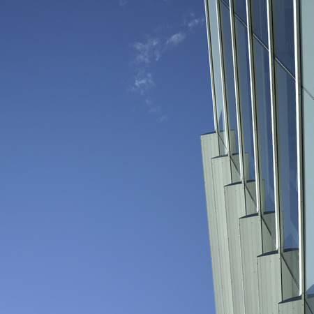 Modern glass and metal building with blue sky Stock Photo