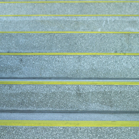 uncluttered: Concrete steps with yellow lines Stock Photo