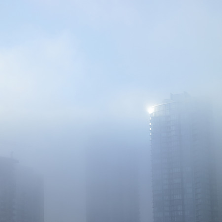 cirrus: Tall tower hidden in a thick fog Stock Photo