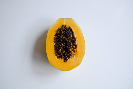 Large papaya cut in half Standard-Bild