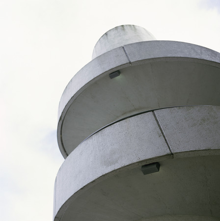 cement chimney: White industrial concrete spiral stairse