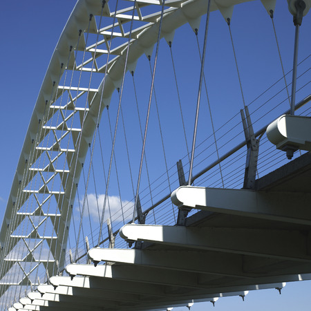 White steel curved modern bridge