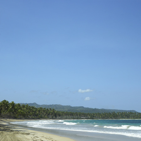 untroubled: Beach on a tropical island with moutain background