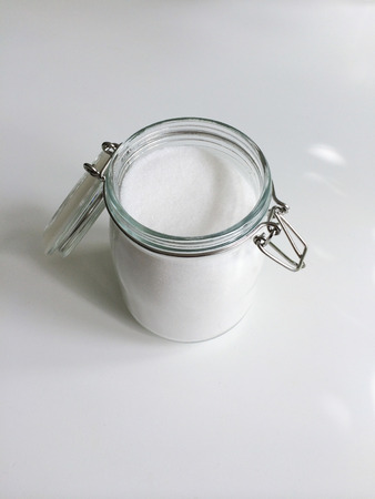 granulated: Open jar of refined granulated sugar