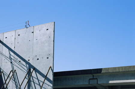 robustness: Construction site of concrete walls and metal beams