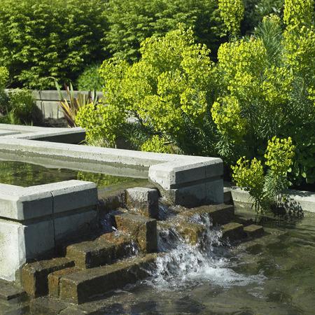 garden fountain: Urban garden with fountain