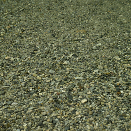 Rocks under clear river water photo