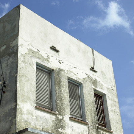 Disheveled small concrete building exterior