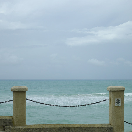 chain fence: Pillar and chain fence overlooking the tropical ocean