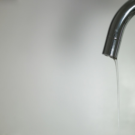 Close up of a silver tap