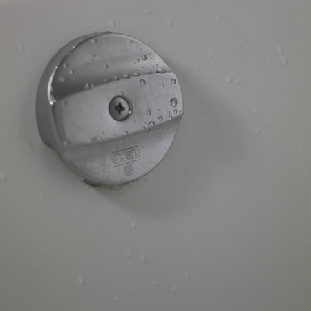 overflow: Close up of an overflow hole cover