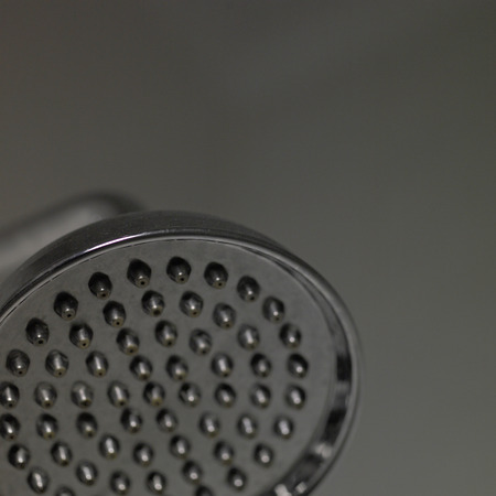 fluoride: Close up of a silver shower head Stock Photo