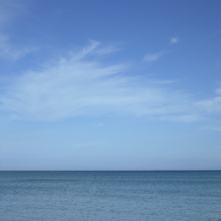 sooth: Turquoise ocean with blue sky and white clouds Stock Photo