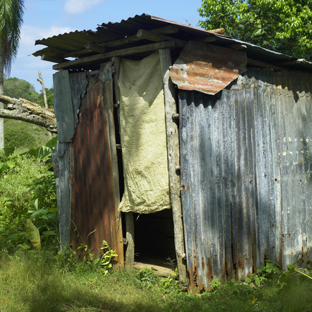 rudimentary: Rudimentary shack with fabric door in a tropical location