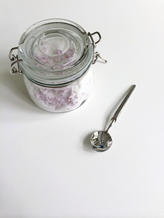 granulated: Glass jar of granulated white sugar and lilac flowers