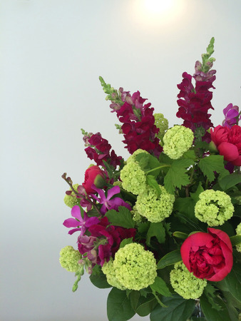 Exotic bouquet of hydrangeas, orchids, snapdragons, peonies and other rare flowers Stock Photo
