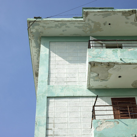 inconsistent: Modest balconies and railings of a low income apartment building