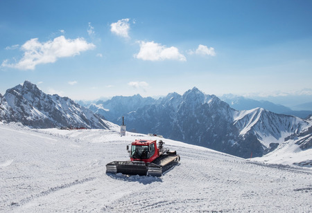 unrepeatable: Snowcat on the top of Germany, Panoramic view of Alps mountain range at Zugspitze Editorial