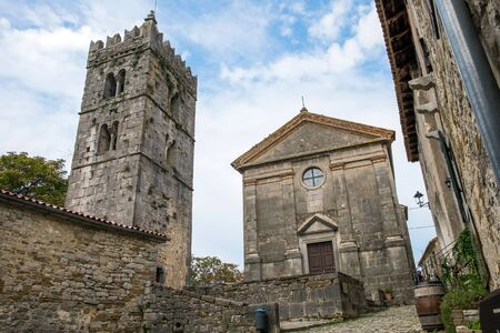 Bell tower and parish church of the Assumption of Mary in famous smallest town in the world - Hum, Croatia 스톡 콘텐츠