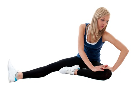 Active young woman stretching on the floor photo