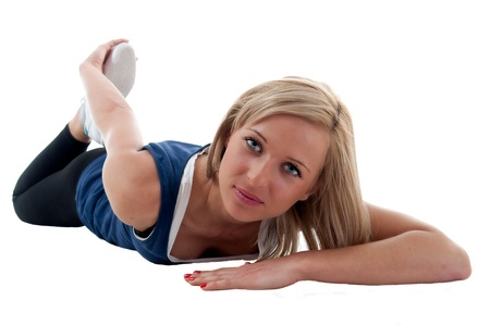 Active young woman doing stretching exercise photo