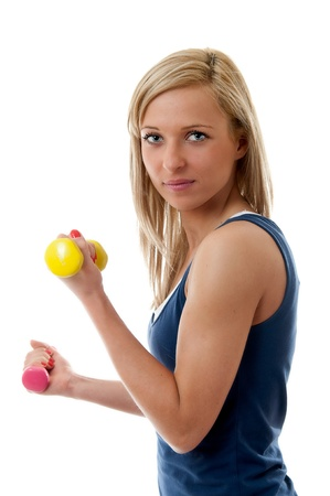 Smiling young fitness woman training with dumbbells photo