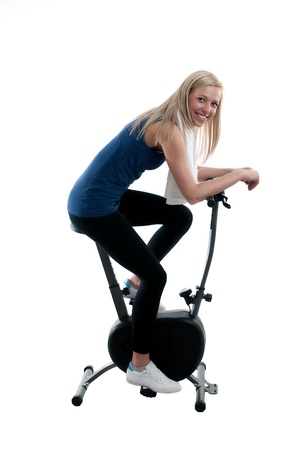 Young woman training on the bike photo