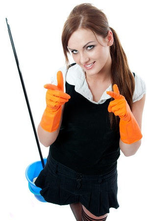 Young smiling housemaid with gloves for cleaning isolated over white background photo