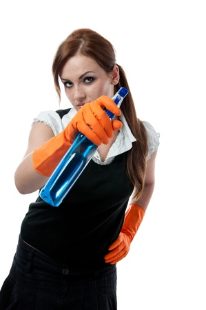 messy house: Young woman with spray bottle  Stock Photo