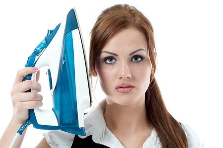 Beautiful woman holding an iron photo
