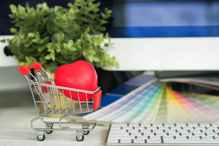 Heart in shopping cart ,romance or valentines gift,on the online business background Stock Photo