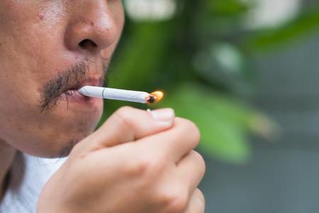 a young man smoking a cigarette Stock fotó