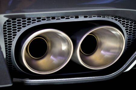 Double exhaust pipes of a sports car 版權商用圖片
