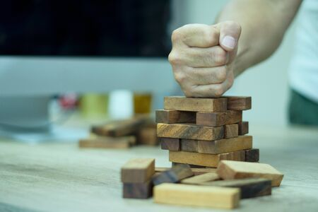 Businessman failuare ideas concept with  hand smash wooden stack block on ground with anger.