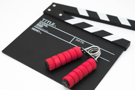 Movie clapper board and  spring grip.
