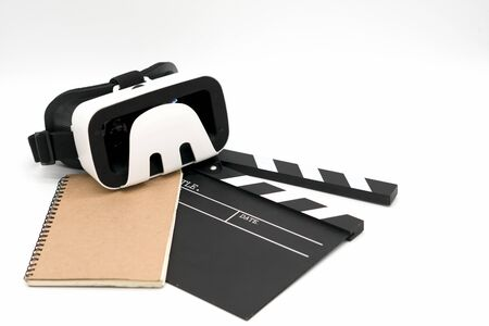 Movie clapper board and note pad on white background.