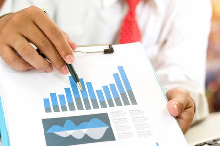 Business analysts, business graphs and marketing charts.