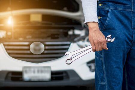 Hand of car mechanic with wrench. Auto repair garage. 版權商用圖片