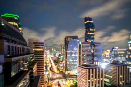 Night blurred bokeh light city office building, abstract background 版權商用圖片