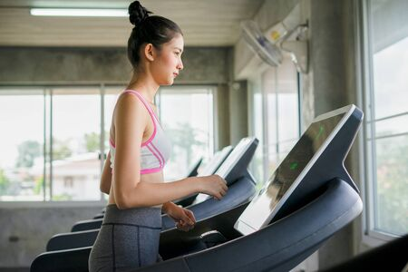 Woman was running on the treadmill in the gym