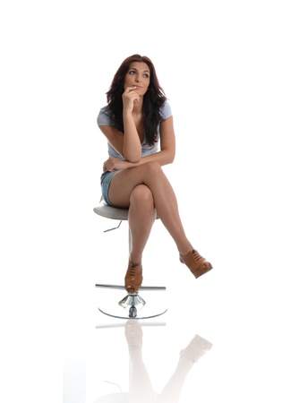stool: Beautiful woman deep in thoughts