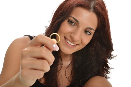 Beautiful lady looking happily to her wedding ring photo